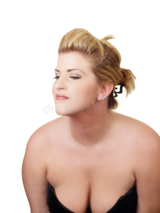 Young woman with low cut dress showing cleavage. Young woman showing cleavage in black dress stock photography