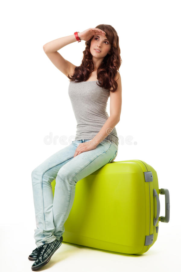 Young woman and luggage bag. Young woman sit on her luggage bag stock photography