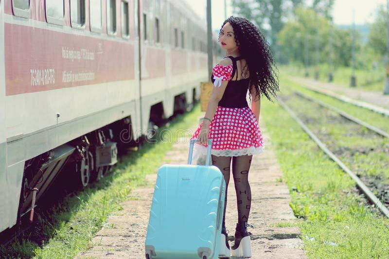 Young Woman With Luggage Standing on Train in City stock photos