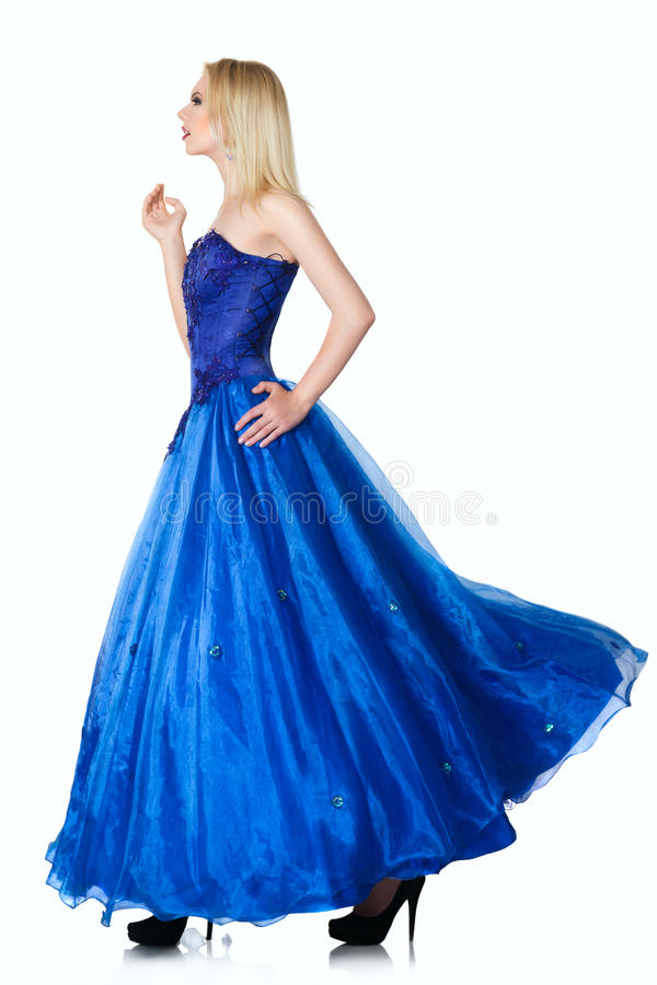 Young woman in luxurious blue dress. Isolated white background royalty free stock images