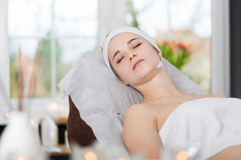 Young woman lying at beautician`s and waiting for spa treatment. Woman during spa treatment lying at beautician`s stock image