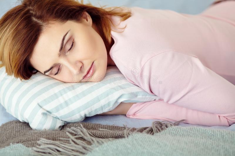 Young woman lying on the bed. girl sleeping at home. stock photo