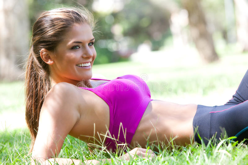 Young Woman Lying Down After Exercising royalty free stock image