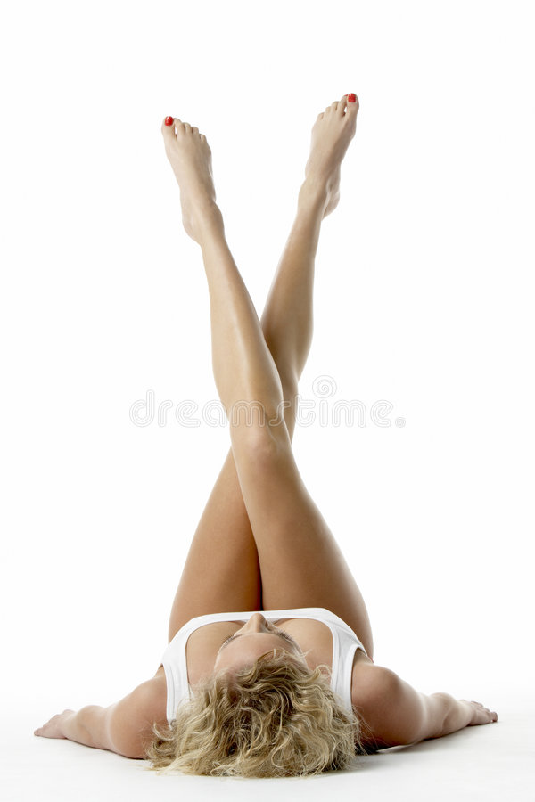 Free Young Woman Lying Down With Her Legs In The Air Royalty Free Stock Photos - 7881868