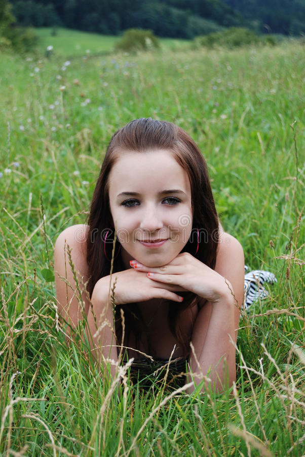 Young Woman Lying On The Grass Royalty Free Stock Photography