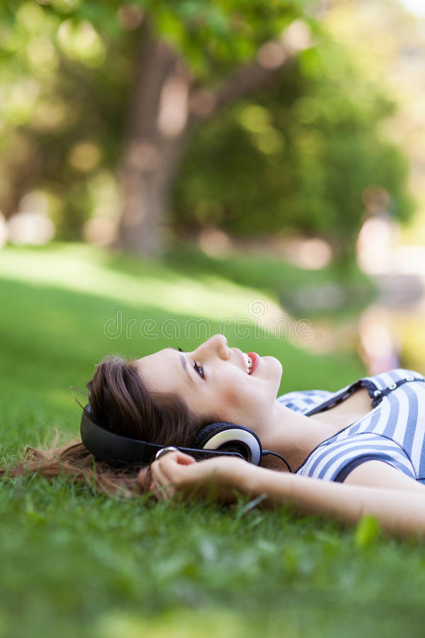 Download Young Woman Lying On Grass Royalty Free Stock Photography - Image: 24929067
