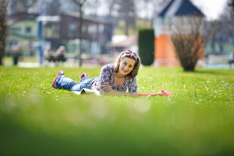 Young woman lying on the grass in the summer stock photos