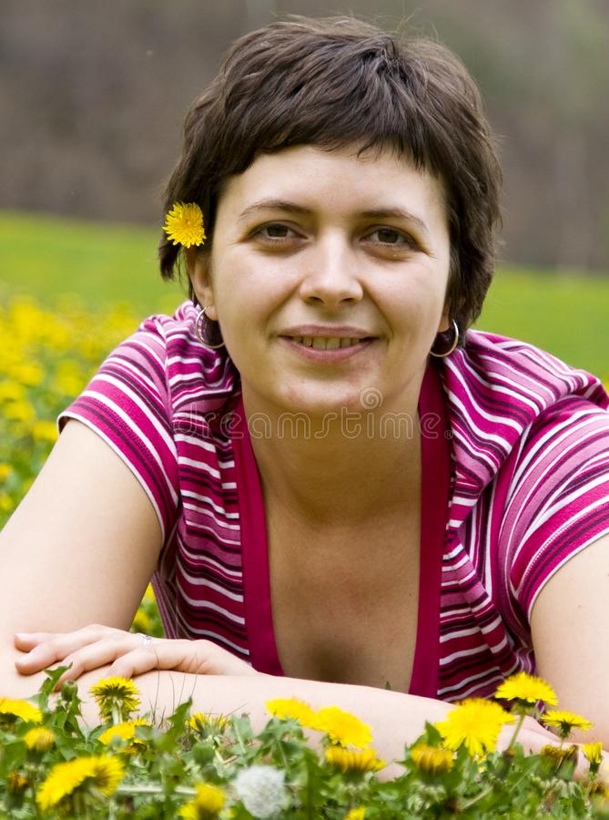 Young woman lying in a meadow stock photo