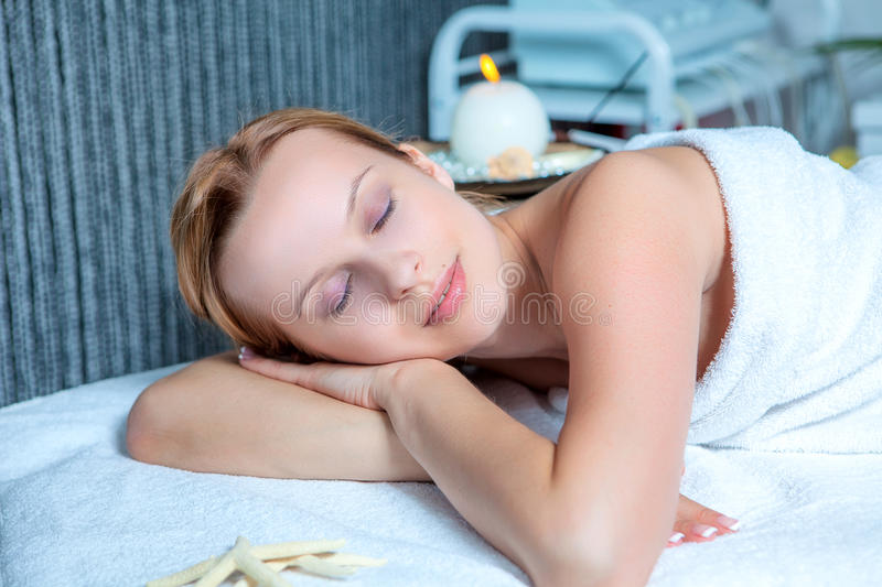 Download Young Woman Lying Relaxed In The Spa Salon Stock Image - Image: 25396617
