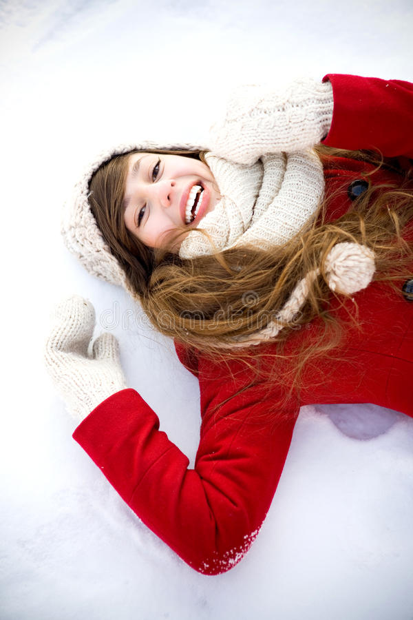 Download Young Woman Lying In The Snow Stock Photo - Image of casual, mittens: 23237932