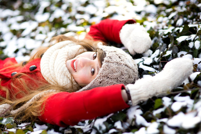 Download Young Woman Lying In The Snow Stock Photo - Image: 23238050