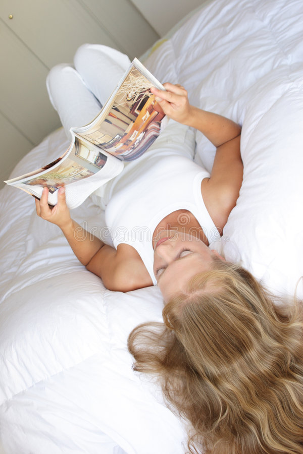 Young woman with magazine royalty free stock photos
