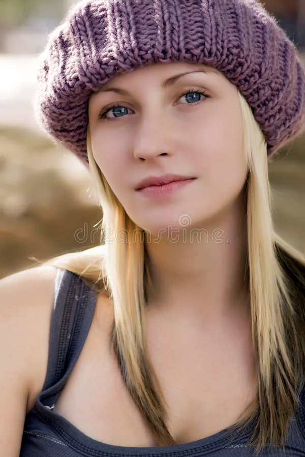 Young woman with magenta  knit hat