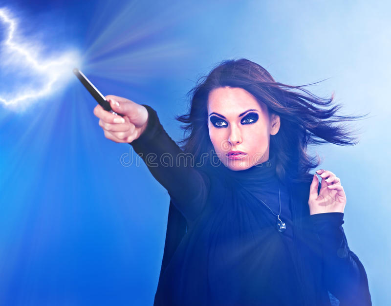 Download Young Woman With Magic Wand. Stock Photo - Image: 21634384