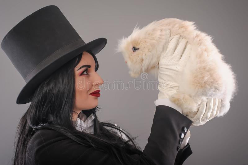 Young woman magician with beautiful white rabbit stock photos