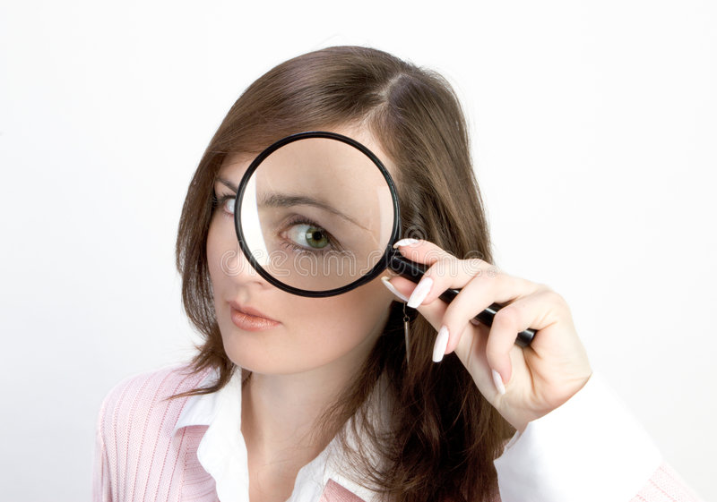 Young Woman with Magnifying Glass stock image