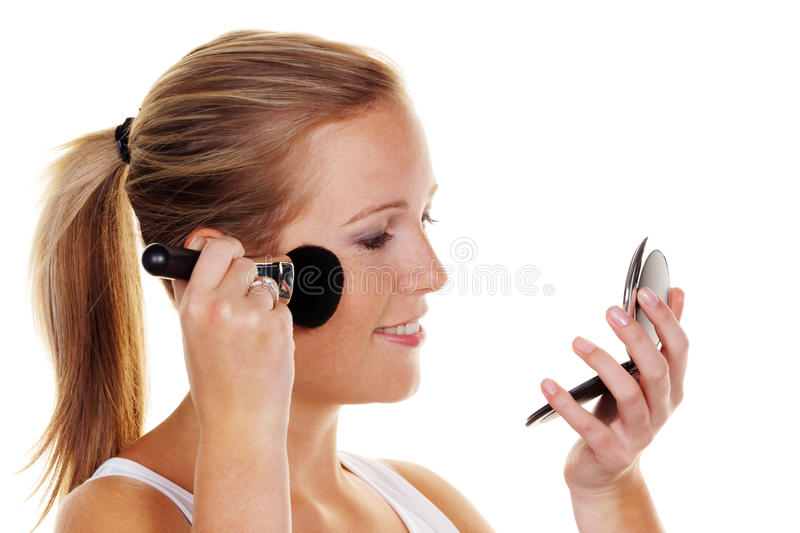 Young woman on make-up stock images