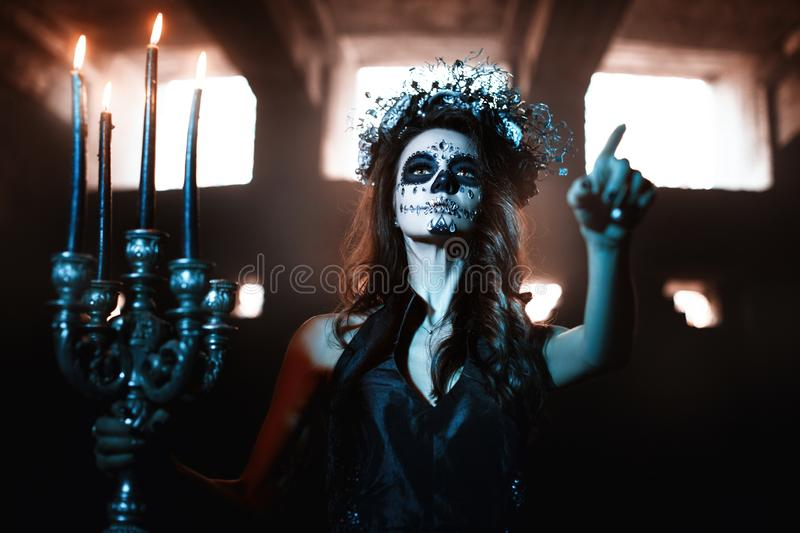 Young woman with make up for the celebration of Halloween stock photography