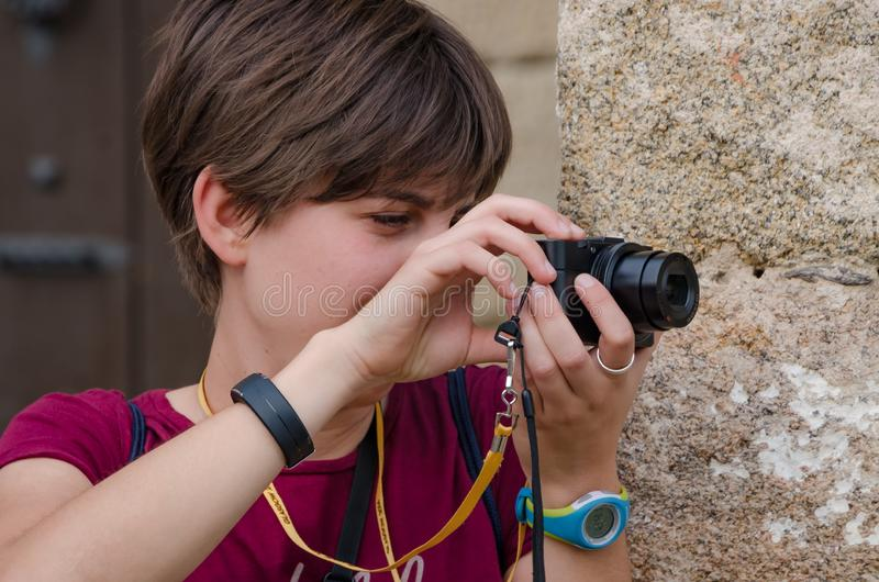 Young woman makes a photograph with a black camera stock photos