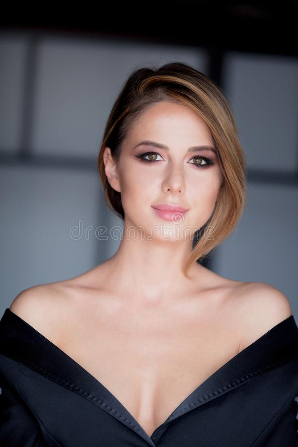 Young woman with makeup in black dress royalty free stock images