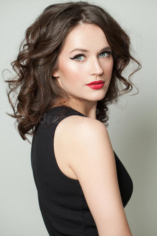 Young woman with makeup and brown hair portrait royalty free stock photography