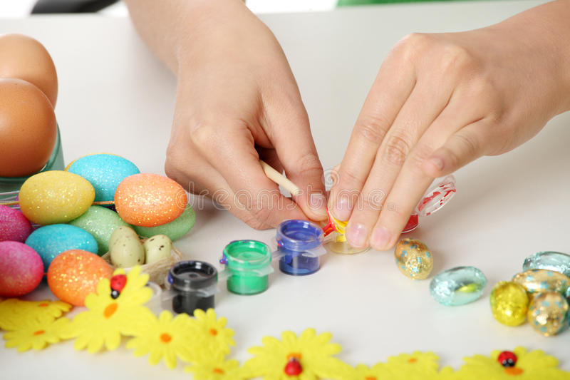 Young Woman Making Easter Decoration Stock Photography