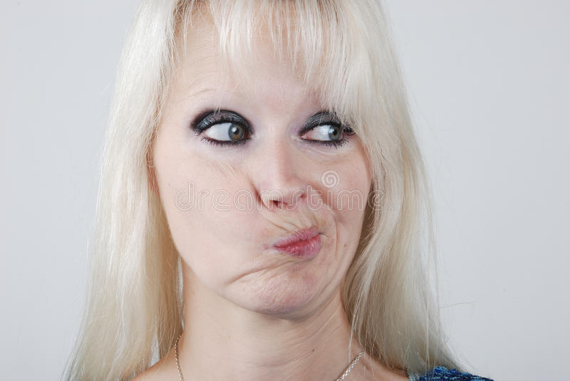 Young woman making a face stock images