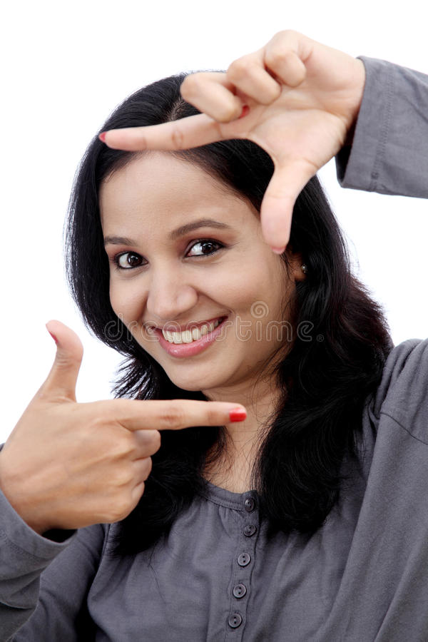 Young woman making frame with her hands stock photos