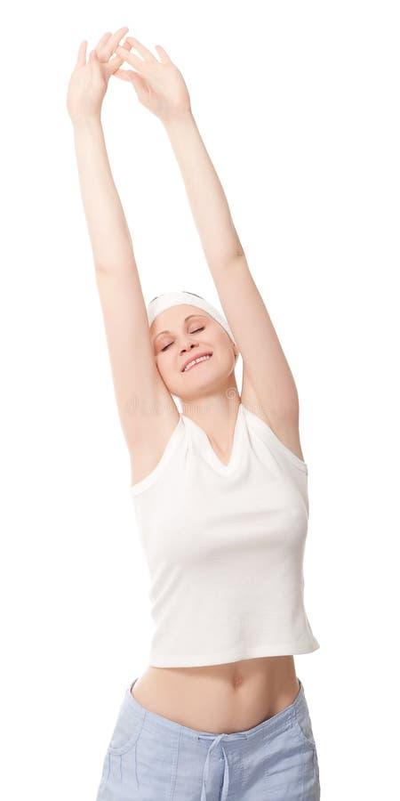 young woman making gymnastics stock image