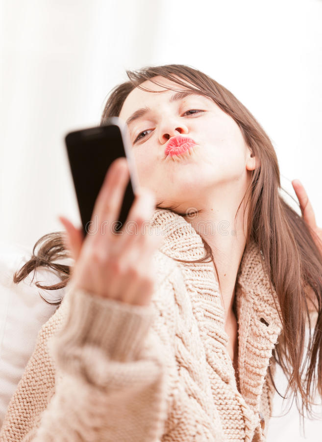 Young woman making herself a selfie stock images