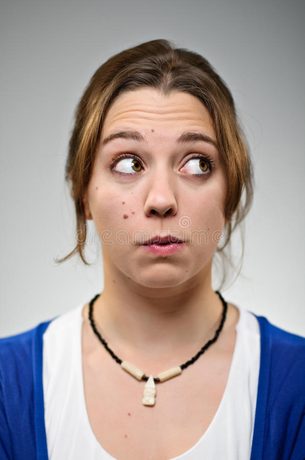 Young woman making the hmm face royalty free stock photo