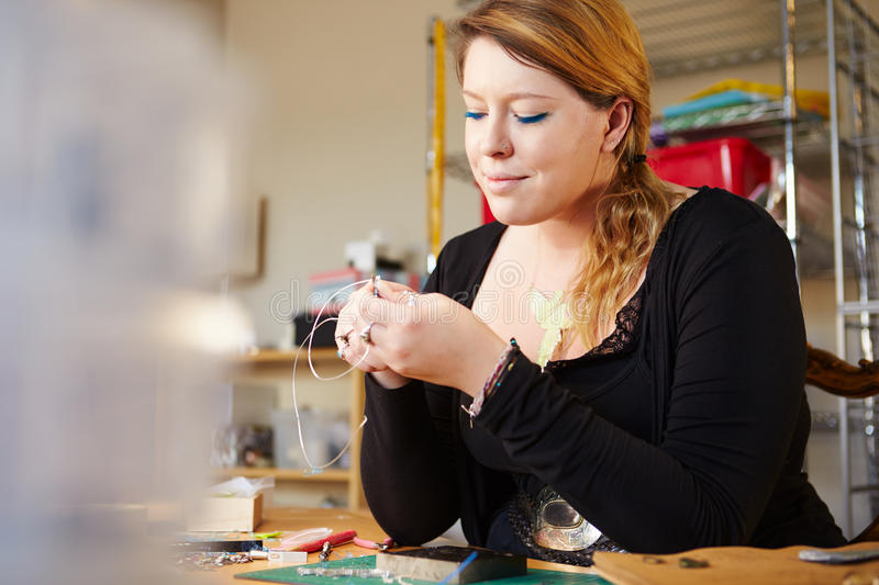 Young Woman Making Jewelry At Home stock images