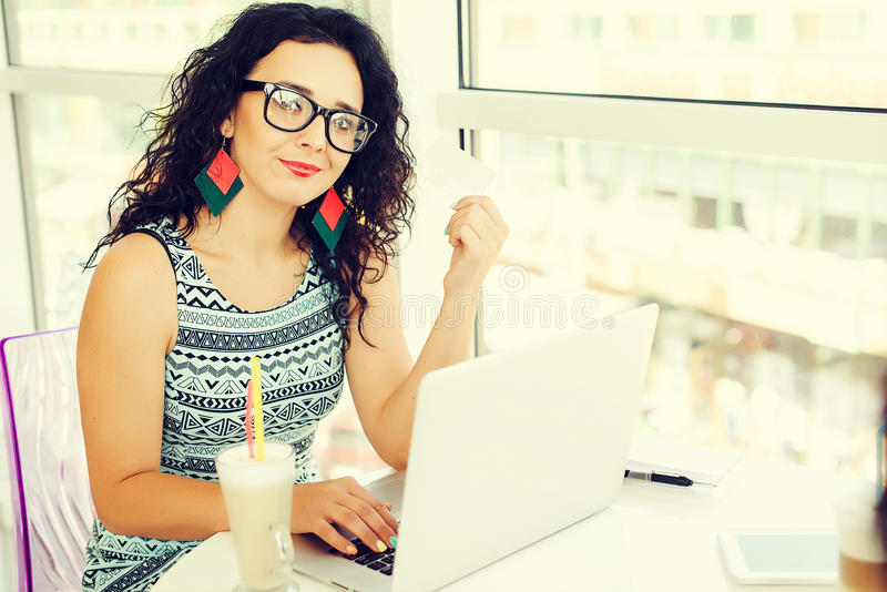 Young woman making online payment with credit card. Shopping online.Concept of new age in banking and plastic money. stock image