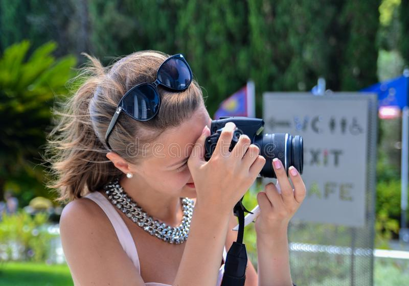 Young woman making photo stock images