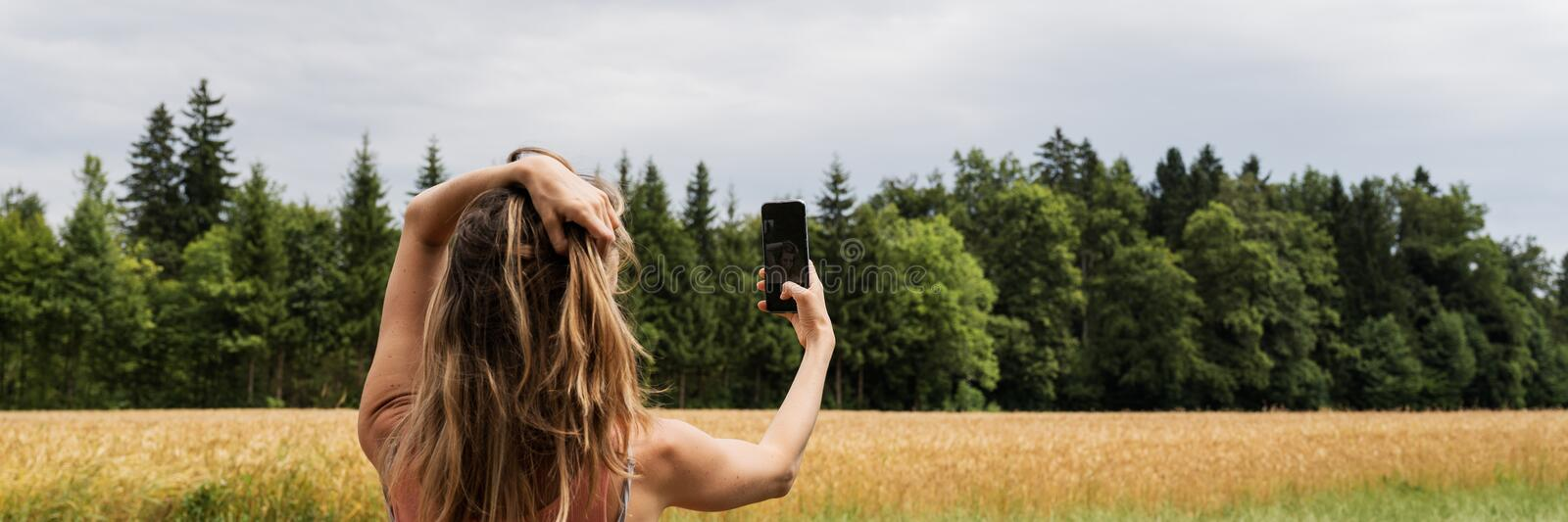 Young woman making a selfie outside royalty free stock image
