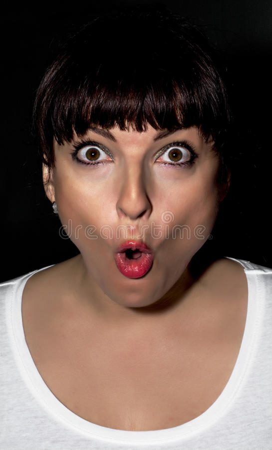 Young woman making surprised face. Young caucasian woman making surprised face royalty free stock image
