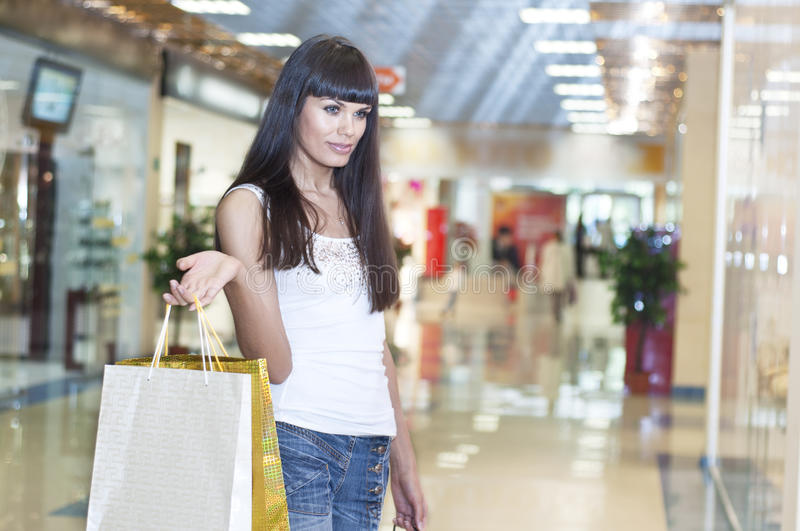 Download Young Woman In Mall Buying Clothes Stock Images - Image: 20780704