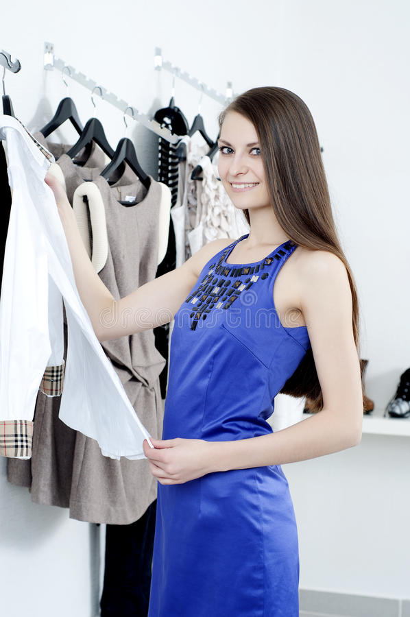 Download Young Woman In Mall Buying Clothes Stock Photo - Image: 22469892
