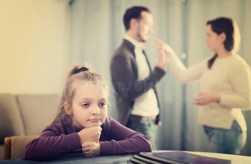 Young woman and man arguing with each other. Young women and men arguing with each other while their daughter at home stock photography