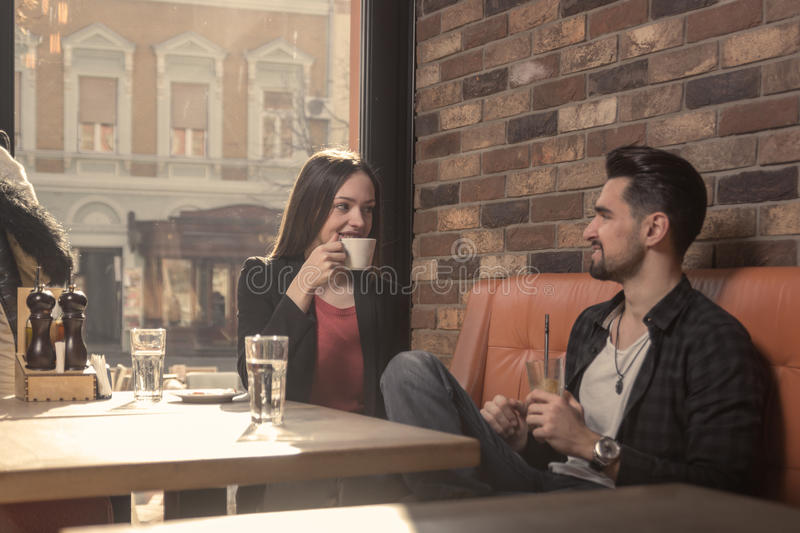 Young woman man cafe drinking indoors sunny day window stock images