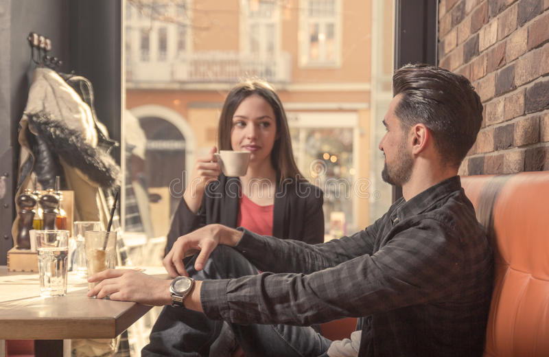 Young woman man cafe indoors talking royalty free stock photos