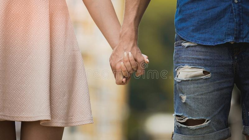 Young woman and man holding hands, tender relationship of sweet couple, love stock images