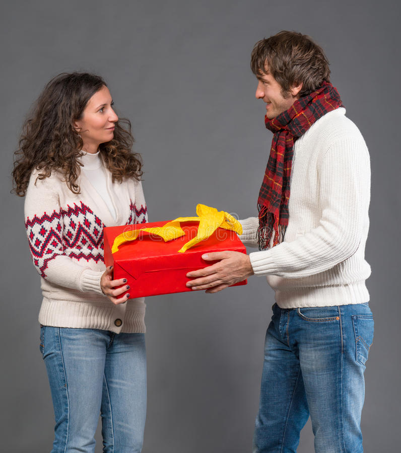 Download Young Woman And  Man With A Present Box Stock Photo - Image: 34482678