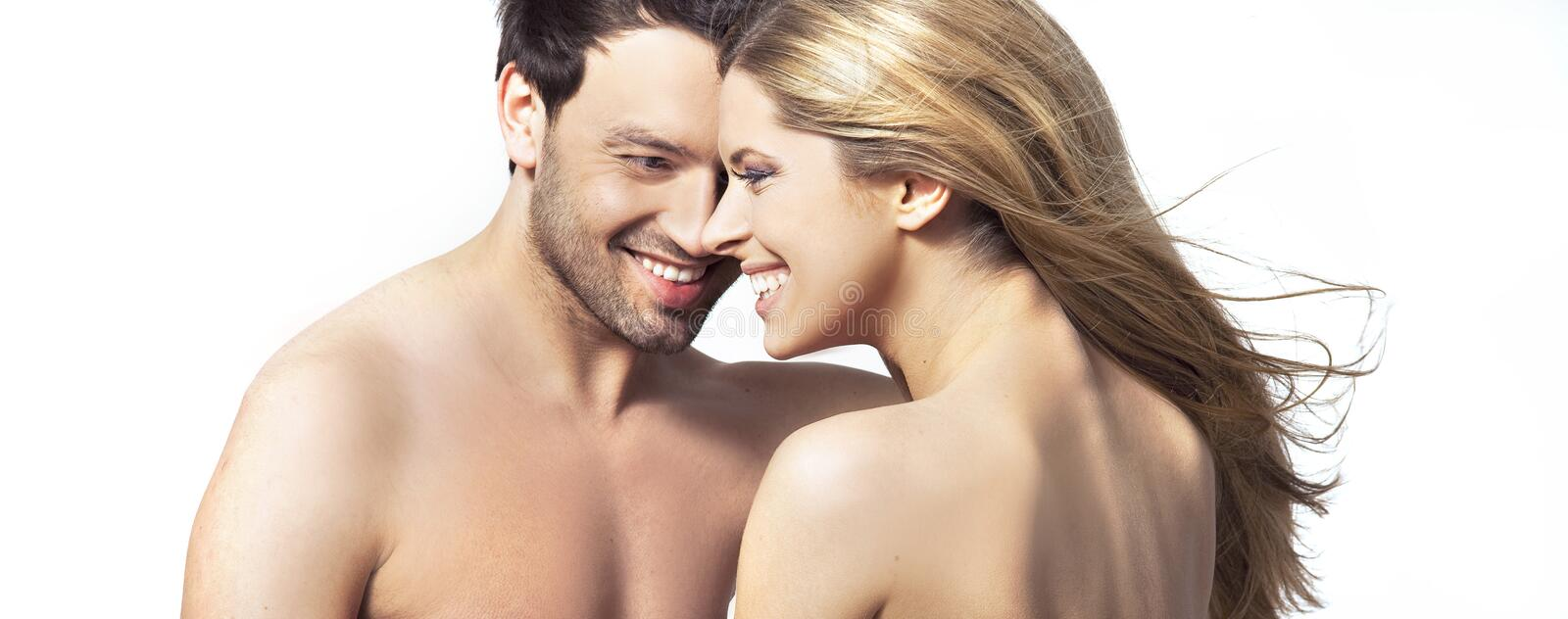 Young woman and man smiling together stock photo