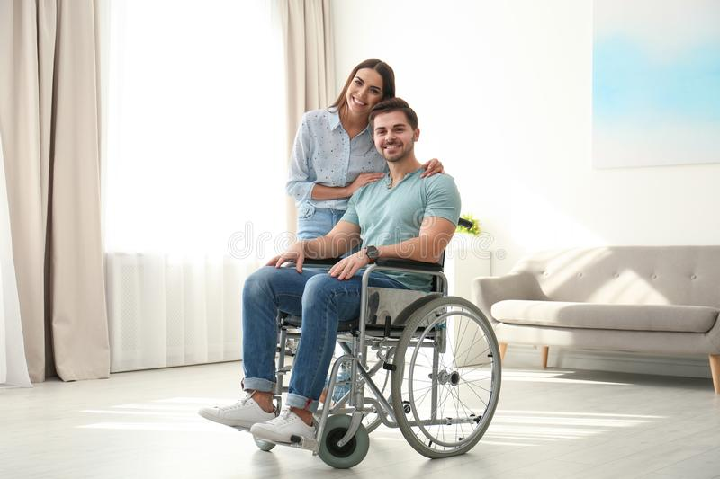 Young woman with man in wheelchair stock images