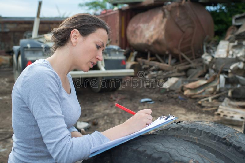 Young woman managing landfill stock images