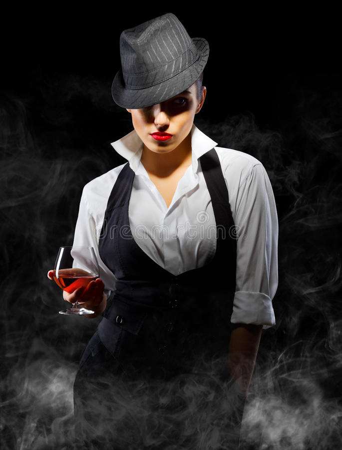 Young Woman In Manly Style With Brandy Glass Royalty Free Stock Photos