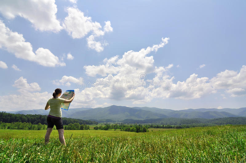 Download Young Woman With Map Exploring A Vast Wilderness Stock Photo - Image: 20414908
