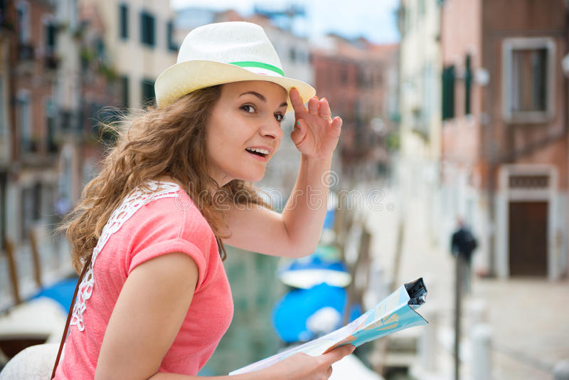 Young woman with map in Venice. Pretty young woman with map in Venice stock image