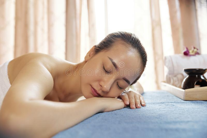Young woman in massage salon royalty free stock photo